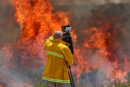 KPBS videographer Christopher Maue shoots near the Vallecito Lightning Complex wildfires on August 15, 2012. Photo courtesy of KPBS News.